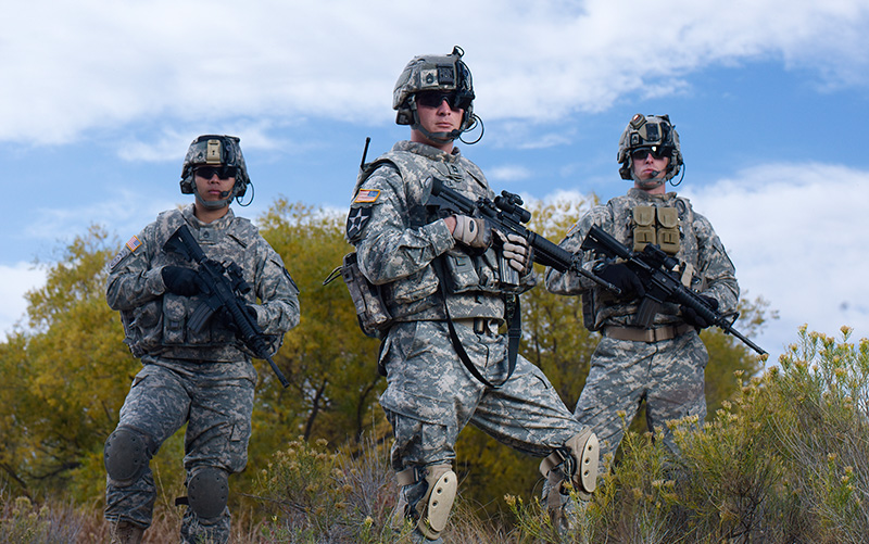 Three U.S. Army Soldiers holding weapons